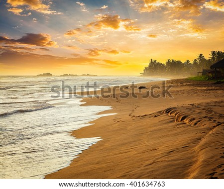 Tropical sunset on ocean beach. Sri Lanka - stock photo