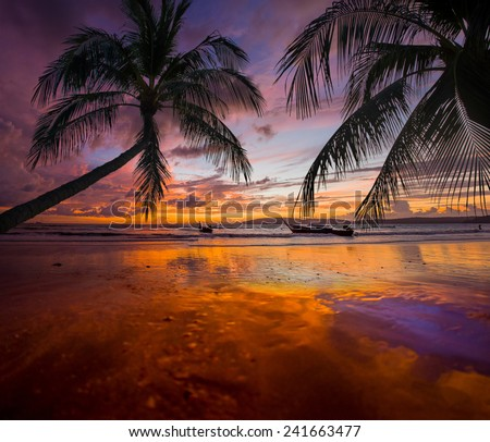 Tropical sunset on the beach. Ao-Nang. Krabi. Thailand at sunset - stock photo
