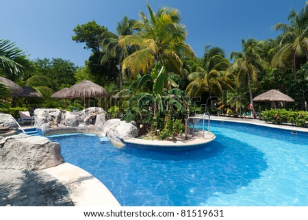 Tropical swimming pool side in Mexico - stock photo