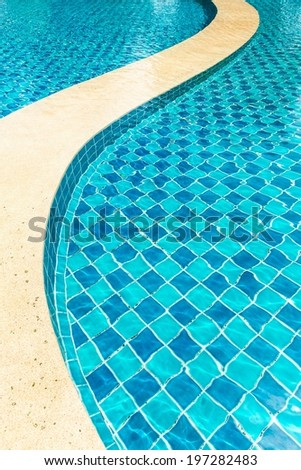 Tropical swimming pool with various curve pattern, taken outdoor - stock photo