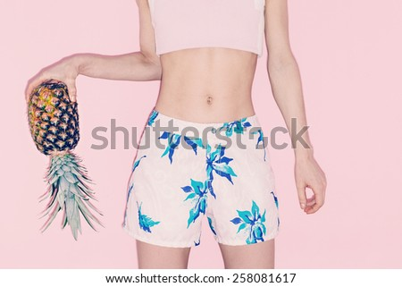 Tropical Vanilla summer. Fashion girl with Pineapple. - stock photo
