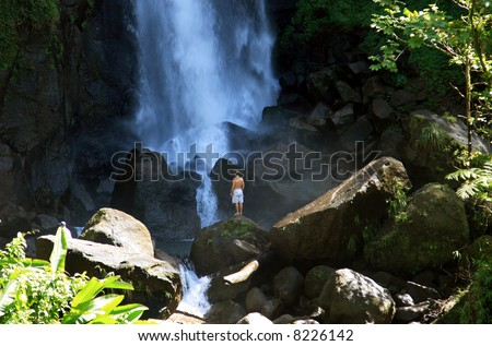 Tropical warm waterfall in the rain forest on the caribbean island of Dominica - stock photo