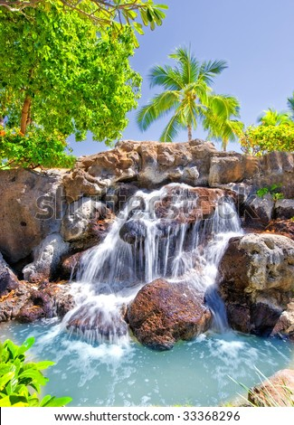 Tropical waterfall at Oahu, Hawaii - stock photo