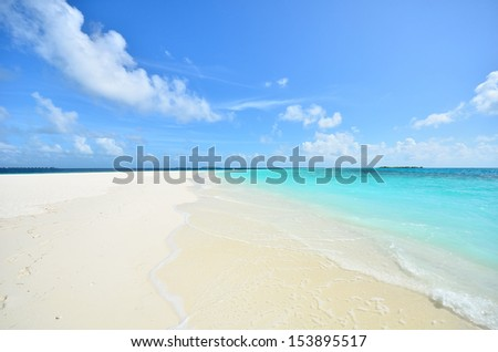 Tropical white sand beach and blue cloudy sky - stock photo
