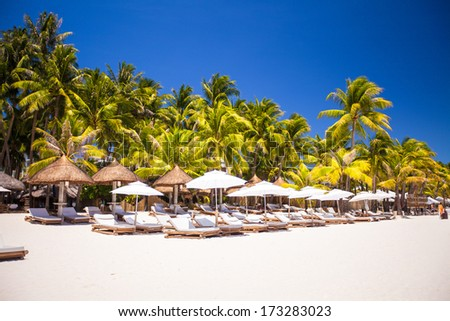 Tropical white sunny beach in beautiful exotic resort - stock photo