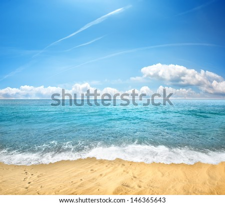 Tropical yellow sand beach and blue sky - stock photo