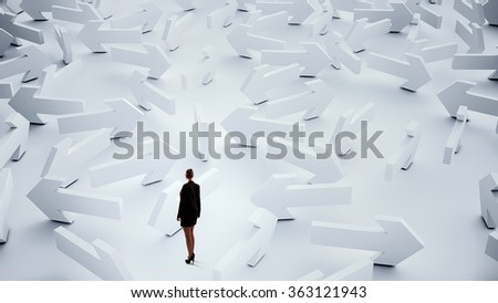 Troubled businesswoman finding way out - stock photo