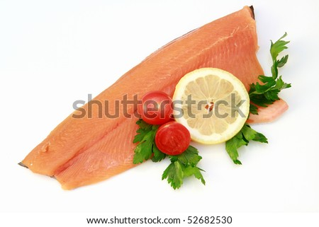 trout fillet with lemon and tomatoes - stock photo