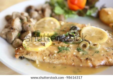 trout fish with lemon sauce - stock photo