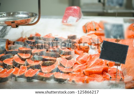 Trout slices on ice table in supermarket - stock photo