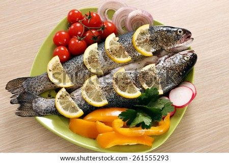trout with vegetables on plate - stock photo
