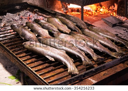Trouts ready to be cooked on the grill. - stock photo