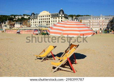 TROUVILLE-SUR-MER, FRANCE - JULY 10, 2015: Beach of Trouville-sur-Mer. Trouville-sur-Mer and nearby Deauville are popular summer resorts in Normandy region.  - stock photo