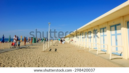 TROUVILLE-SUR-MER, FRANCE - JULY 10, 2015: Wooden cabins at the beach of Trouville-sur-Mer. Trouville-sur-Mer and nearby Deauville are popular summer resorts in Normandy. - stock photo