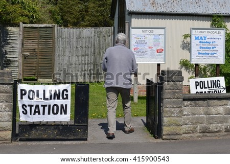 Trowbridge, UK - May 5, 2016:  A voter visits a polling station at a church. Voters are electing members for Scottish Parliament, Welsh Assembly, Northern Ireland Assembly and English Local Councils. - stock photo