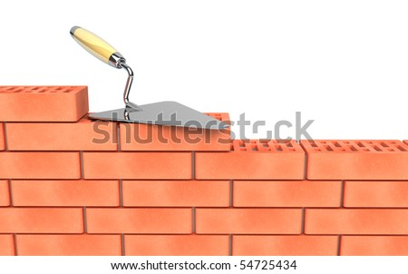 Trowel and bricks wall construction - stock photo