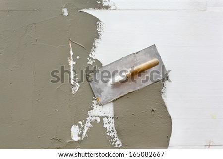 Trowel at mortar finish over styrofoam insulation - stock photo