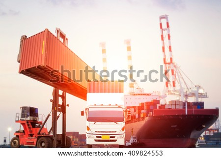 Truck and Container Cargo freight ship with working crane bridge in shipyard at dusk for Logistic Import Export background - stock photo