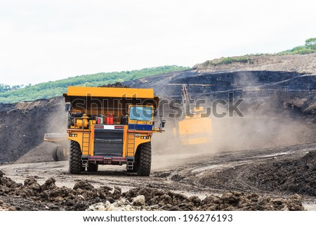 Truck and Electric Shovel in Open Pit North of THAILAND - stock photo