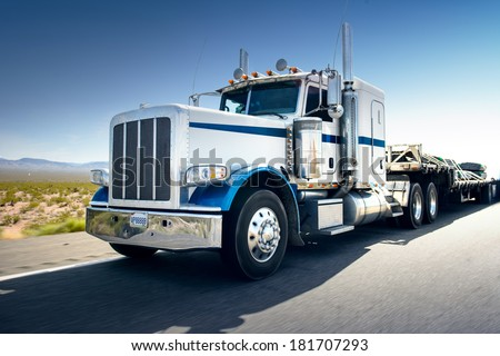 Truck and highway at day - transportation background - stock photo