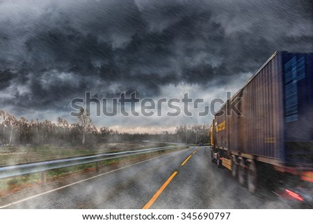 Truck at road during a heavy downpour. - stock photo