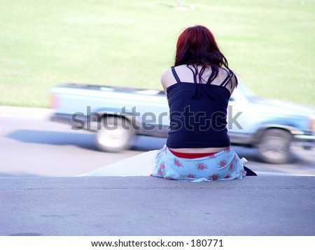 Truck blur and sitting girl - stock photo