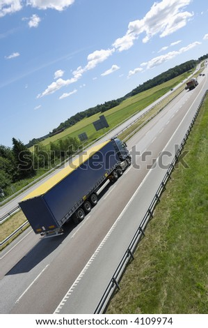 truck driving on highway in an extreme perspective idea - stock photo