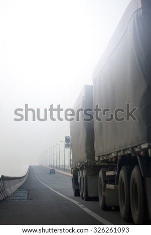 Truck in the smoke-haze pollution by the forest fire and burning of plantation in Indonesia. - stock photo