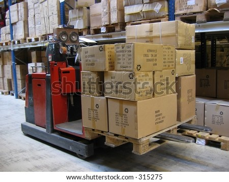 Truck in warehouse - stock photo