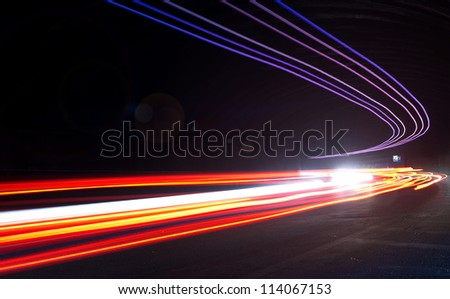 Truck light trails in tunnel. Art image with lens flares . Long exposure photo taken in a tunnel - stock photo