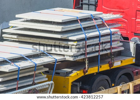Truck loading safety, overcharging. Correct mounting of the transport object. - stock photo
