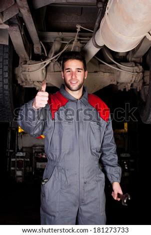Truck mechanic thumbs up.  - stock photo