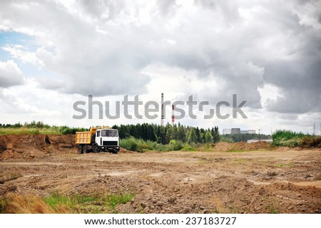 Truck on a construction site, excavation - stock photo