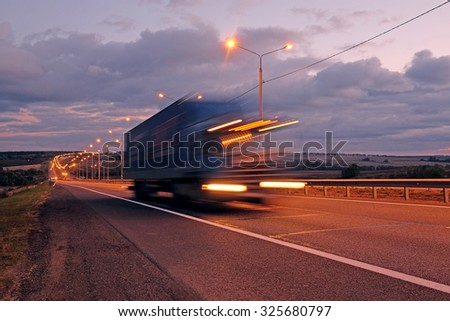 Truck on a highway in the night - stock photo