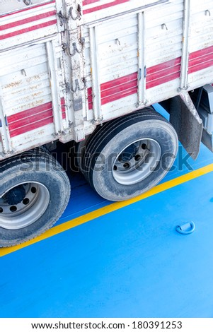 truck on a ramp of a ferry - stock photo