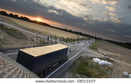 Truck on asphalt road motion blur - stock photo