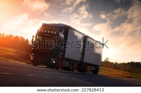 Truck on country highway - stock photo