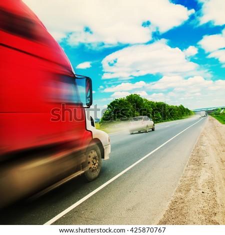 Truck on Road Summer Landscape Transportation Far Distances Toned - stock photo
