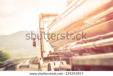 Truck on the freeway.blurred image about transportation and highway - stock photo
