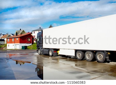 Truck on the streets of a small town after rain - stock photo