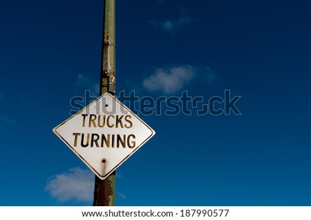 Truck turning street sign - stock photo