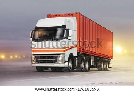 truck with cargo container on ice road in blizzard - stock photo