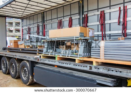 Truck with cargo - Truck with full charge without securing loads - stock photo