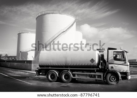 Truck With Fuel Tank  and industrial storage site - stock photo