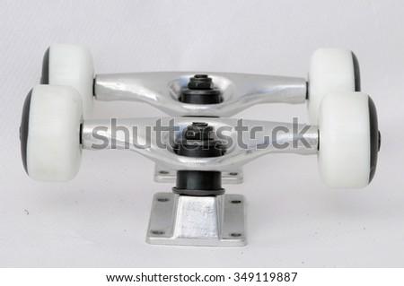 Trucks and white wheels on a white bacground - stock photo