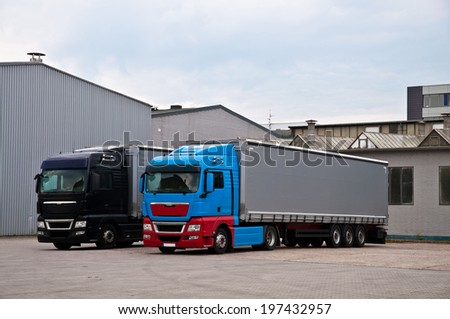 Trucks in a loading area of a factory - stock photo