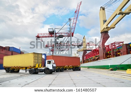 Trucks in container terminal in a harbor - stock photo