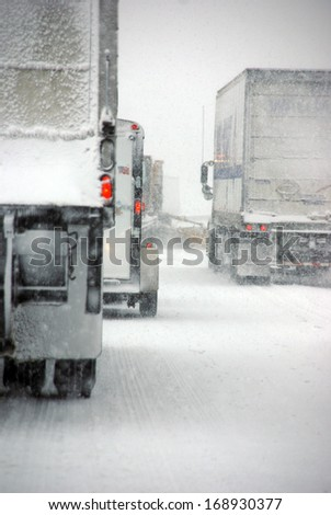 Trucks on winter highway during snowstorm,   Oregon, Pacific Northwest - stock photo