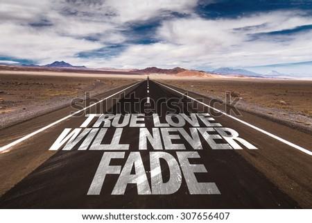 True Love Will Never Fade written on desert road - stock photo