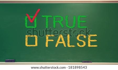 TRUE or FALSE check box on green chalkboard - stock photo